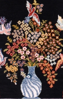 "Detail of the Hereke silken rug ""Mihrab with Nazar Boncuk"""